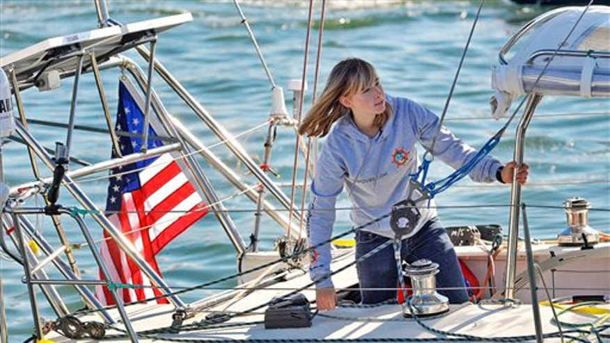 Jan 23: Abby Sunderland, 16, looks out from her sailboat, Wild Eyes, as she leaves for her world record attempting journey at the Del Rey Yacht Club in Marina del Rey, Calif.
