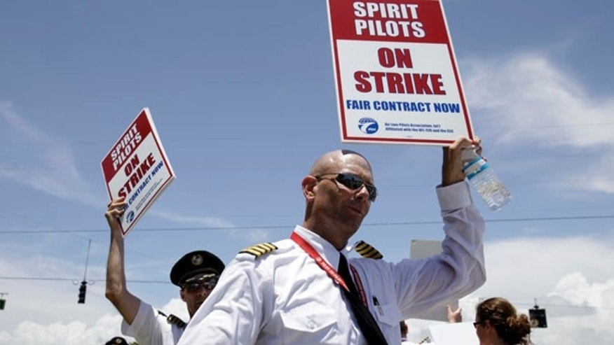 June 13: Spirit Airlines pilots picket nearby Fort Lauderdale-Hollywood International Airport in Florida. Spirit Airlines canceled all of its flights through Tuesday, stranding thousands of passengers as the pilot's strike continues into its second day.