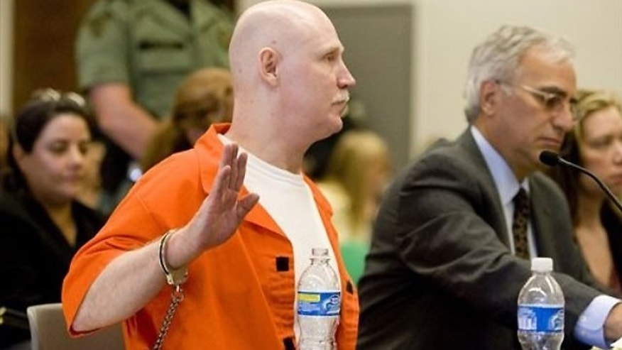 June 10: Ronnie Lee Gardner is sworn in before speaking at his commutation hearing at the Utah State Prison in Draper, Utah.