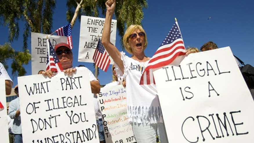 June 5: Arizona residents rally in support of the state's new immigration law near the state capitol in Phoenix.