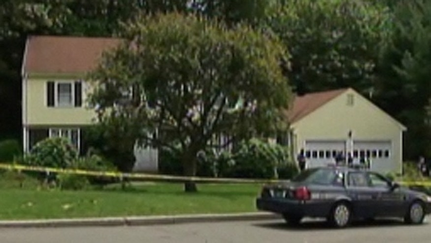 """June 16: Four family members, including two young children, were found dead Wednesday in what a prosecutor called a """"horrific"""" scene at their home in an affluent Boston suburb."""