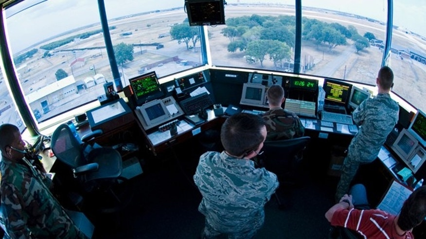FILE: Air traffic controllers from the 37th Operations Support Squadron prepare to navigate F-16 Falcons down the runway on Lackland Air Force Base.