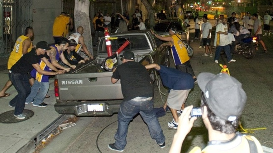 June 17: Unruly fans vandalize a pickup truck in downtown Los Angeles following the Los Angeles Lakers' win.