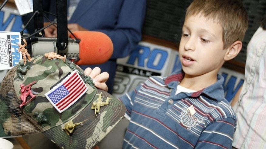 June 18: David Morales, 8, from Coventry, R.I., shows his decorated army hat during an appearance on WPRO-AM's John DePetro radio show in East Providence, R.I.