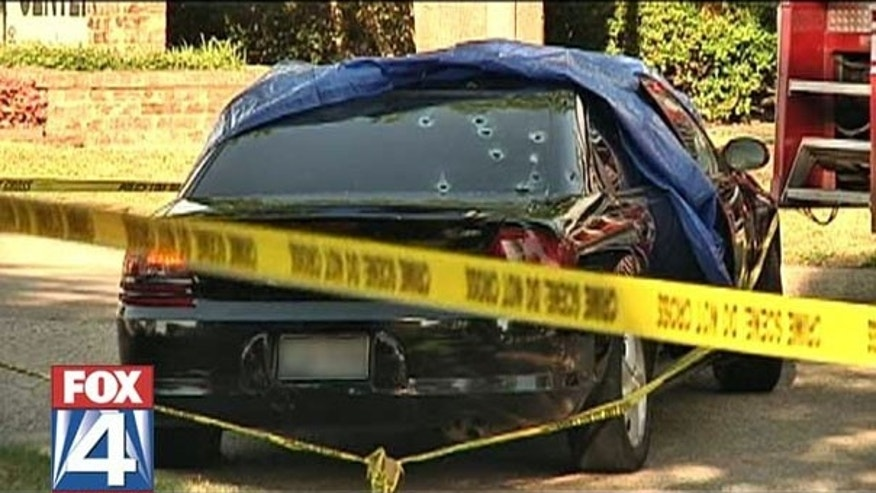 June 21: A car parked outside an apartment complex in Lancaster, Texas, just south of Dallas, is riddled with bullets after a shootout that claimed the lives of three people, including a police officer and the son of the Dallas police chief, who is not no the force.