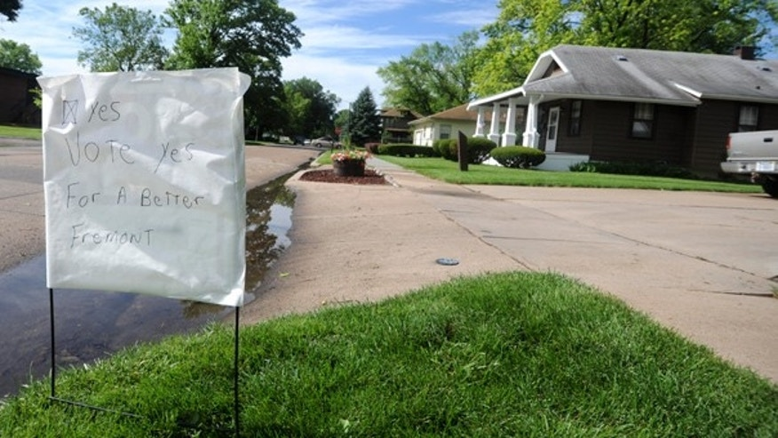 June 21: A home-made sign urges residents to vote yes on a proposed municipal ordinance that would ban hiring or renting property to illegal immigrants in the city of Fremont, Nebraska.