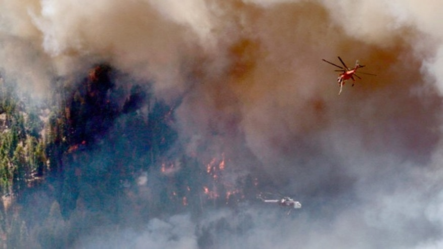 June 21: Firefighters attack the Schultz Fire using helicopters, near Flagstaff, Arizona.