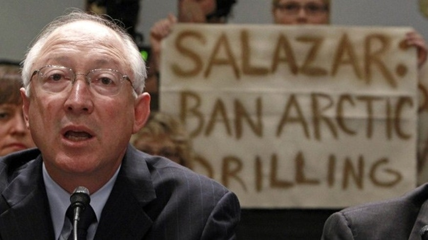 May 26: Greenpeace protesters hold up a banner as Secretary of the Interior Ken Salazar testifies before the House.