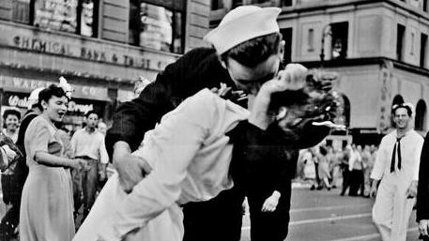 August 14, 1945: An American sailor kisses a nurse to celebrate the end of World War II. The nurse, Edith Shain, died June 23, 2010, at age 91.