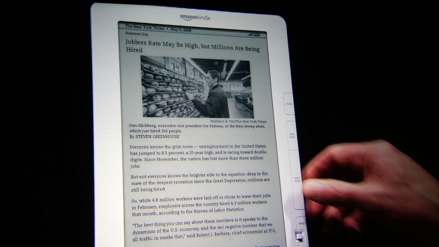 May 6: The Kindle DX, displaying a page from The New York Times, is demonstrated at a news conference in New York. Online retailer Amazon.com Inc. said it is introducing a new version of its higher-end Kindle at a lower price as competition among electric-book readers intensifies. (AP)