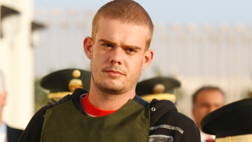 June 4, 2010: Dutch citizen Joran van der Sloot is escorted by police officers outside a Peruvian police station, near the border with Chile in Tacna, Peru.