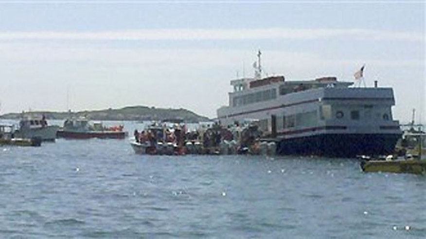 July 3: In this photo released by the U.S. Coast Guard, citizens and state and local agencies assist the Coast Guard in evacuating 168 passengers and six crew members from passenger vessel The Massachusetts that ran aground and began taking on water in Boston Harbor Saturday morning.