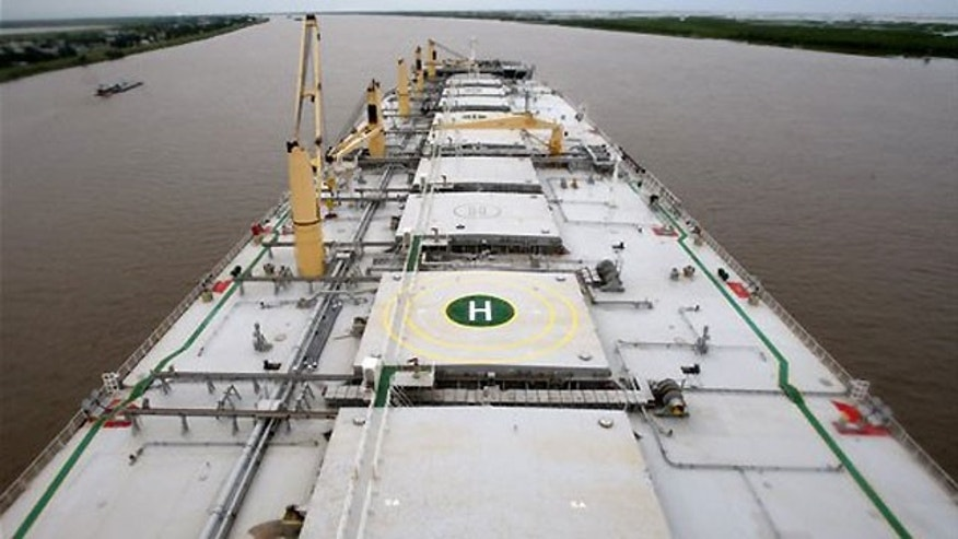 "June 30: The deck of the ""A Whale"" skimmer, billed as the world's largest oil skimming vessel, is seen from its bridge while anchored on the Mississippi River in Boothville, La."