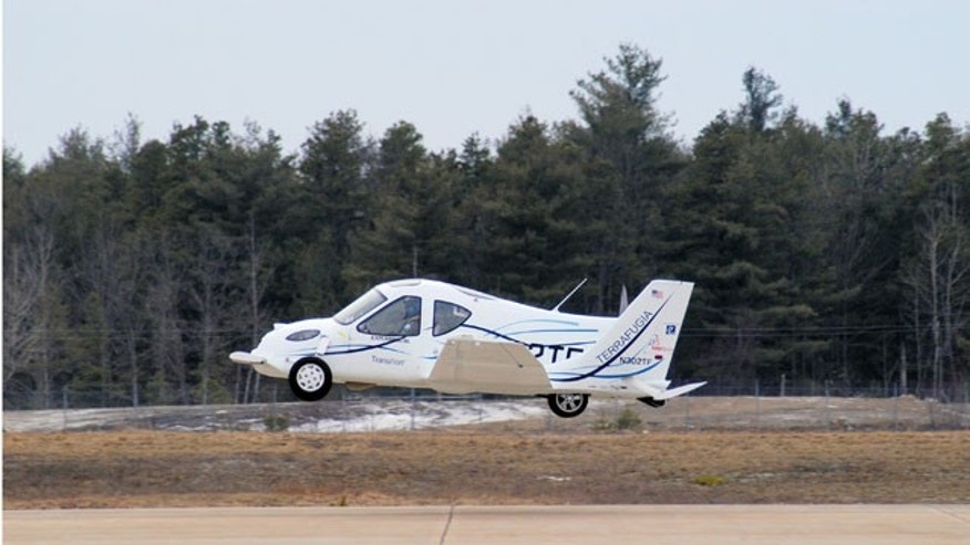 The Terrafugia Transition gains air shortly after a takeoff. A major hurdle to production of the planes was removed recently when FAA granted the company a waiver to weight restrictions. (AP)