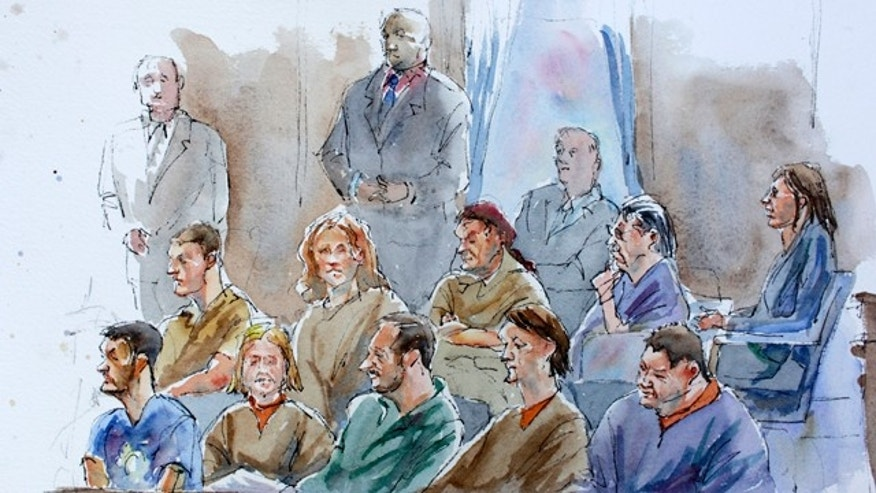 July 8, 2010: This courtroom sketch shows bottom row from right, Richard Murphy, Cynthia Murphy, Donald Howard Heathfield, Tracey Lee Ann Foley, Michael Zottoli, top row from right, Patricia Mills, Juan Lazaro, Vicky Pelaez, Anna Chapman, and Mikhail Semenko during their arraignment in in Manhattan federal court.