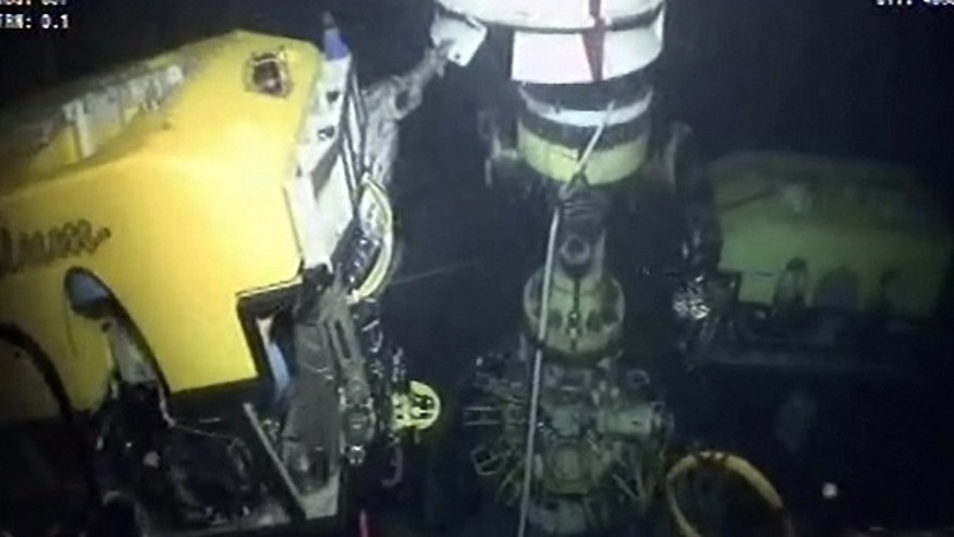 July 12: The new containment cap is lowered over the broken wellhead at the site of the Deepwater Horizon oil spill in the Gulf of Mexico.