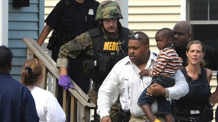 July 12: Police remove a child from a home in Highland Park, Mich., where a woman reportedly held her 3-year-old grandson hostage for several hours.
