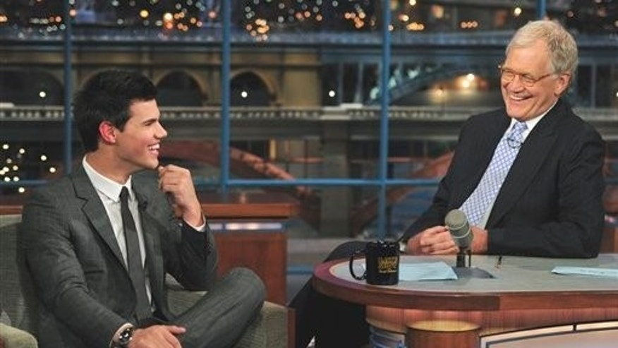"June 30: Taylor Lautner, left, who stars in ""The Twilight Saga: Eclipse,"" joins host David Letterman on the set of the ""Late Show with David Letterman"" (AP)"