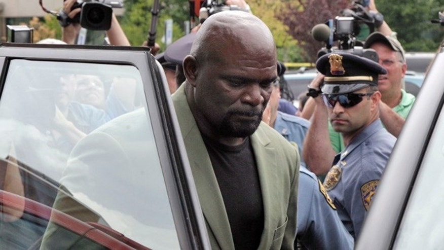 July 13: NFL Hall of Fame linebacker Lawrence Taylor gets into his car after a court appearance at Rockland County courthouse in New City, N.Y.