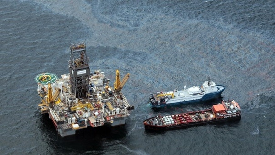 July 16: Workboats operate near BP's Transocean Development Drilling Rig II at the site of the Deepwater Horizon explosion in the Gulf of Mexico.