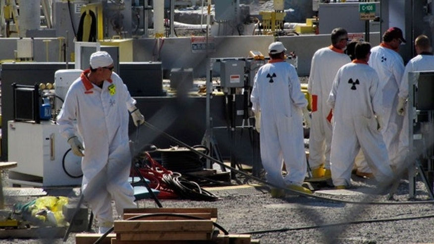 July 14: Workers at the Hanford nuclear reservation near Richland, Wash., work in a tank farm where highly radioactive waste is stored underground. A commission examining U.S. nuclear waste policies visited the site Wednesday. (AP)