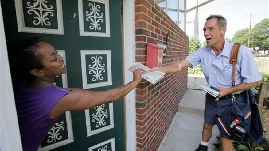 July 16: Ohio letter carrier Keith McVey hands the day's mail to Raina Washington as he makes his daily deliveries in Akron, Ohio. The veteran mailman has gained a reputation for three-times delivering people from life-threatening situations while on the job delivering mail. Last week he gave CPR to a man along his Akron route who wasn't breathing and whose lips were turning blue. (AP)