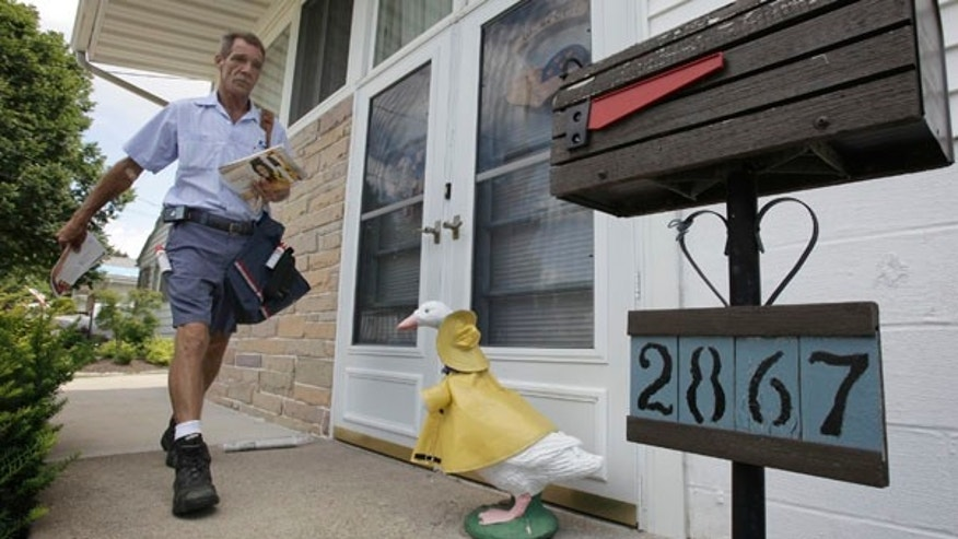 July 16: Ohio letter carrier Keith McVey walks his route delivering mail in Akron, Ohio. The veteran mailman has gained a heroic reputation for delivering people from life-threatening situations three separate times while on the job delivering mail.