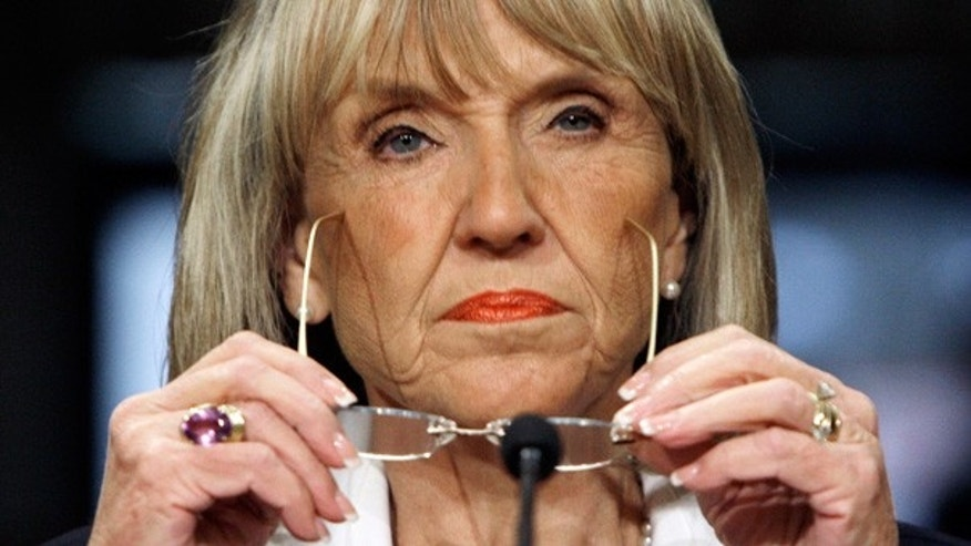 Arizona Gov. Jan Brewer listens during a meeting on violence along the U.S.-Mexico border, in Phoenix.