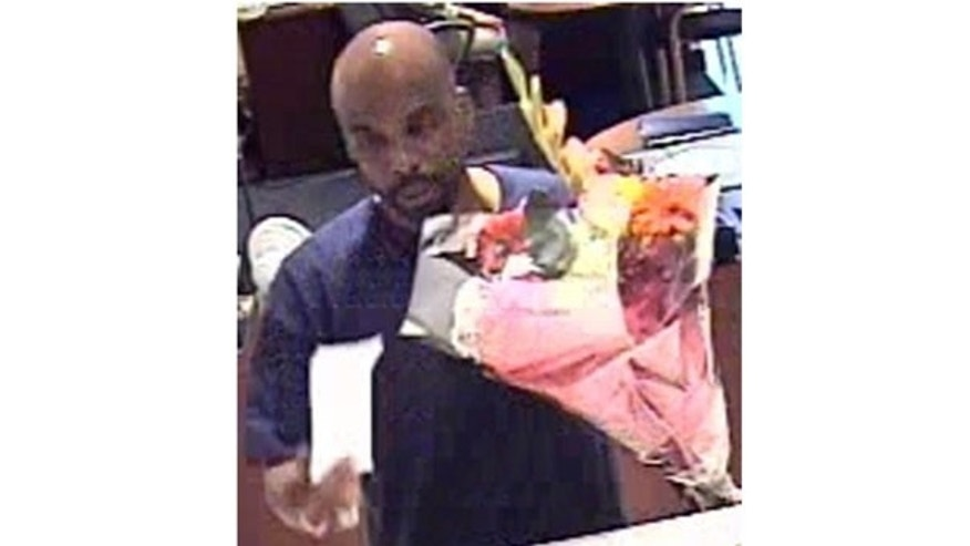 July 15: Security footage shows a man robbing a New York City bank armed only with a bouquet of fresh flowers.