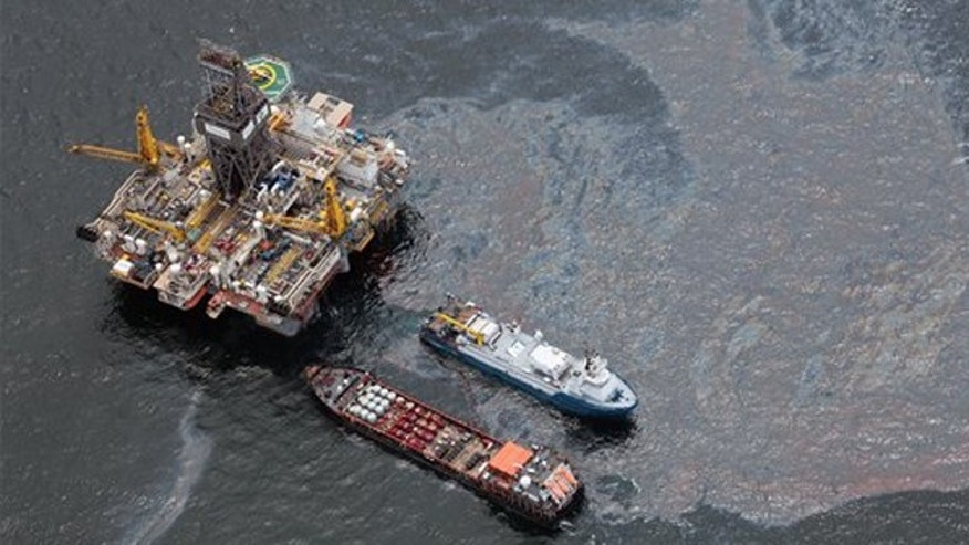 July 16, 2010: Workboats operate near the Transocean Development Drilling Rig II at the site of the Deepwater Horizon incident in the Gulf of Mexico. The wellhead has been capped and BP is continuing to test the integrity of the well before resuming production.
