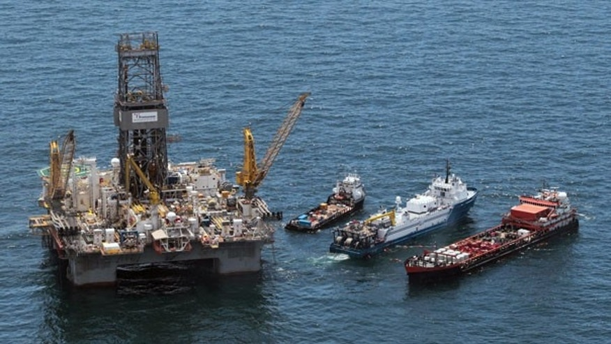 July 17: Work boats operate next to the Transocean Development Driller III at the site of the Deepwater Horizon oil spill in the Gulf of Mexico.