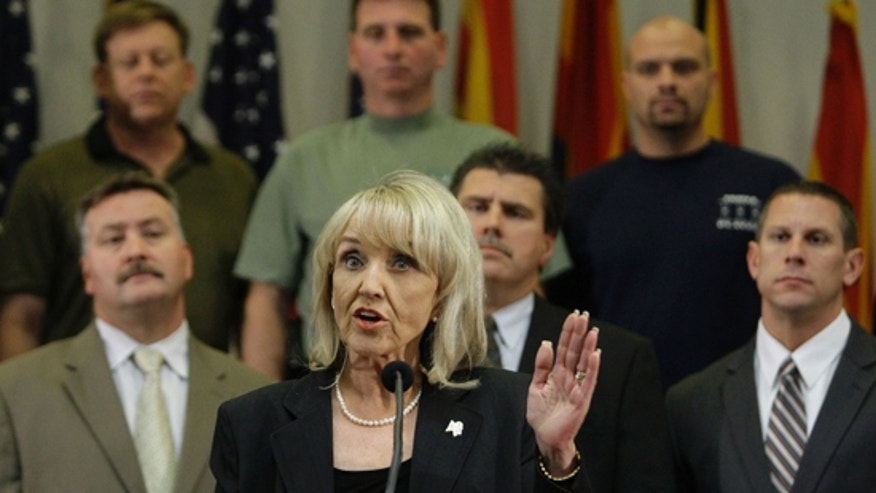 FILE: In this Apr. 23, 2010, photo, Arizona Gov. Jan Brewer talks about signing the immigration bill that is now the subject of a potential Supreme Court appeal.
