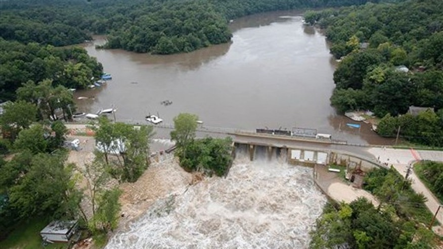 July 24, 2010: Maquoketa River water surges over the bridge of the Delhi Dam as areas surrounding the Maquoketa River continue to flood.