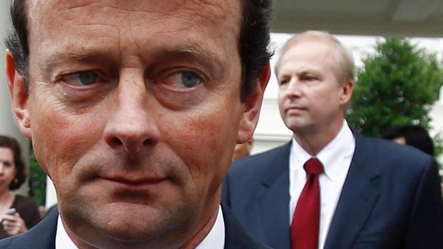 June 16, 2010: BP CEO Tony Hayward and Managing Director Bob Dudley, in background, are seen leaving the White House after meeting with President Obama.