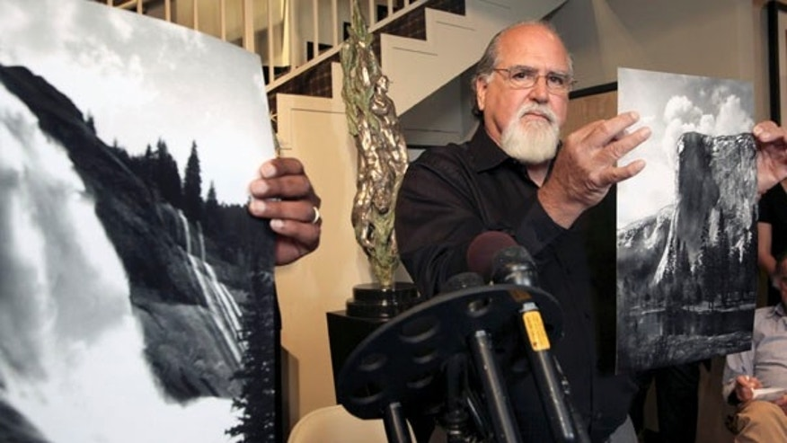 July 27: Rick Norsigian holds up a photograph made from a glass negative shot by the late photographer Ansel Adams during a news conference in Beverly Hills. A lawyer says the trove of old glass negatives found in a garage sale for $45 by Norsigian has been authenticated as the work of  photographer Ansel Adams and is worth at least $200 million.