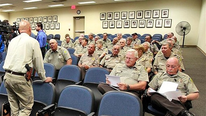 July 28: Maricopa County Sheriff's deputies receive training on how to enforce Arizona's new immigration law, in Phoenix.