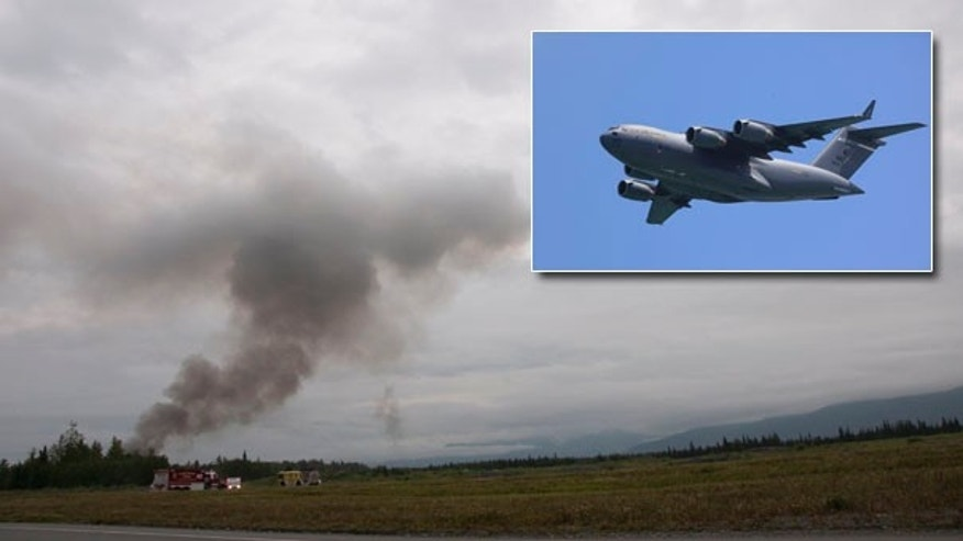 July 28: A plume of smoke is seen after a C-17 military cargo plane crashed on the Elmendorf Air Force Base in Anchorage, Alaska, killing all 4 airmen on board.