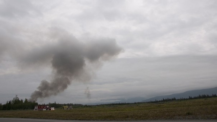 July 28: A plume of smoke is seen after a C-17 military cargo plane crashes on the Elmendorf Air Force in Anchorage, Alaska. (AP)