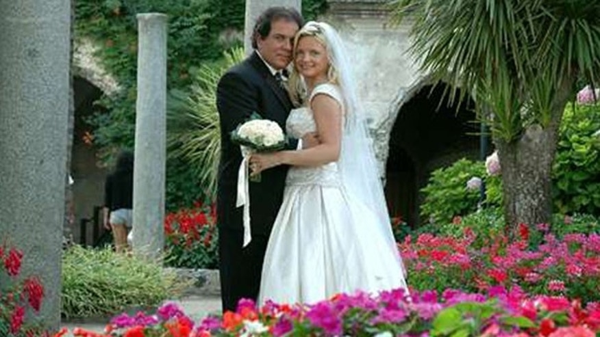 Lynn France and her husband John France pose for a July 2005 wedding photo in Italy. Lynn France says she discovered on Facebook that her husband married for a second time.