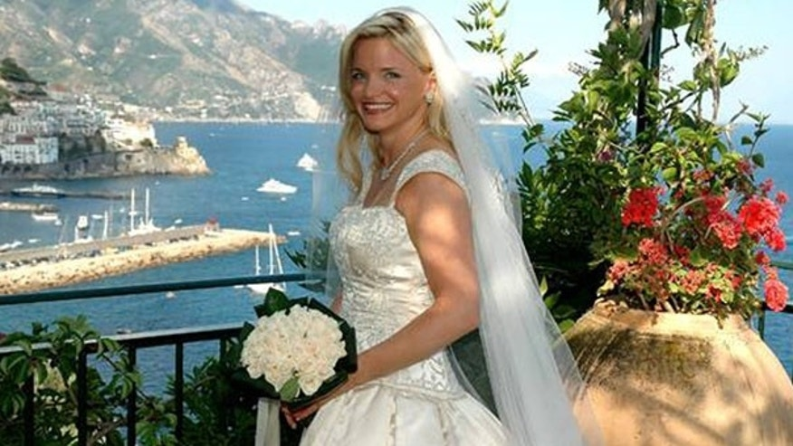 Lynn France, seen in this July 2005 wedding photo in Italy, says she discovered on Facebook that her husband married for a second time.