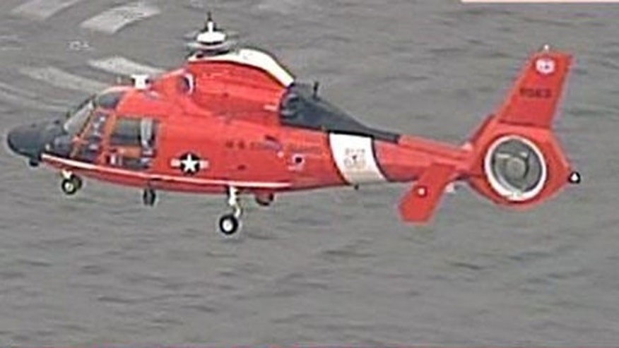 A Coast Guard official says crews are searching the Delaware River after a woman called a drug counselorat a Philadelphia hospital to report that she had thrown her baby and two young children from the Ben Franklin Bridge.