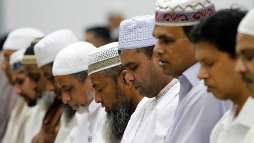 Aug. 11: Muslim men pray at the Darul Uloom Institute in Pembroke Pines, Fla., on the first day of Ramadan.