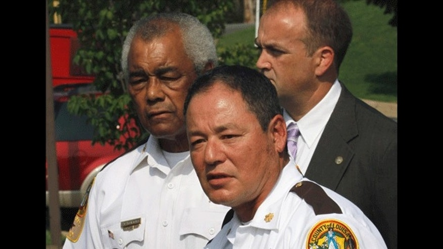 August 23: Major Donald Lowe Chief Deputy of the Louisa County Sheriff's department, speaks during a news conference along with Sheriff Ashland Fortune in Louisa, Va. A gunman opened fired Sunday during a domestic dispute, killing two people and injuring four others before he was killed by police. (AP)