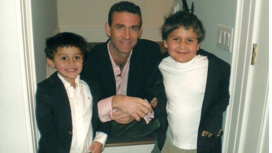 Colin Bower is pictured in this undated photo with his sons, 7-year old Ramsay and 9-year old Noor