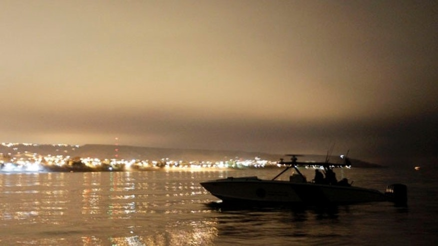 July 30: A U.S. Customs and Border Protection speedboat is silhouetted by the lights of Tijuana, Mexico, along of the coast of San Diego. California-Mexico coastline is the new frontier for illegal immigrants entering the United States a roughly 400-square-mile ocean expanse that stretches from a bullring on the shores of Tijuana, Mexico, to suburban Los Angeles. (AP)