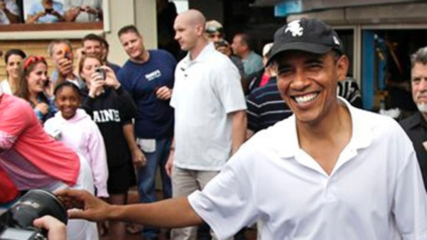 Aug. 25, 2010: President Obama greets people outside Nancy's Restaurant in Oak Bluffs, Mass., while the first family is vacationing on Martha's Vineyard.