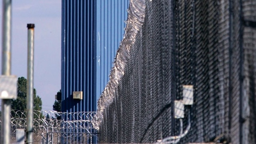 In this Aug. 31, 2007, file photo, a guard tower is seen behind the wire fence that surrounds California State Prison, Sacramento, in Folsom, Calif. Authorities say five inmates at Folsom State Prison have been shot by guards after a riot broke out at the prison Friday night Aug. 27, 2010.