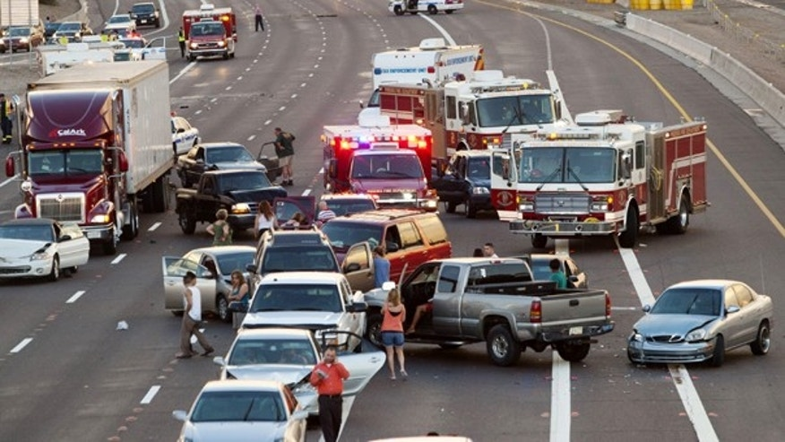 Aug. 28: This photo shows some of the vehicles involved in a multi-car accident in Phoenix. Authorities say 69 vehicles were involved in at least three separate collisions in the area.