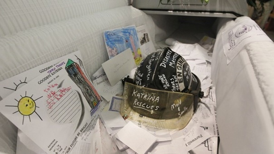 "aug. 28: Notes and items which were placed by community members are seen in a ""Katrina casket "" during an Ecumenical funeral service for Hurricane Katrina at Our Lady of Prompt Succor Catholic Church in Chalmette, La."