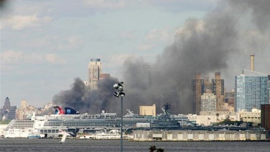 Sept. 4, 2010: Smoke rises from the Hudson River docks on New York City's west side after fire broke out in trash filled containers on a pier operated by the New York City Sanitation Department. More than 130 firefighters have responded to a smoky fire.